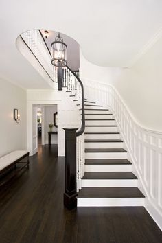 love the moulding and dark rail and step treads. Same shape as our staircase. Traditional Staircase Design, Pictures, Remodel, Decor and Ideas Best White Paint, White Paint Colors, Neutral Paint, Wall Colors, Sol Sombre, Traditional Staircase, Staircase Design, Curved Staircase, White Staircase