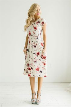 Absolutely lovely, perfectly describes this new cream floral dress! It is flowy, beautiful and has the prettiest peach, coral and gray floral print.