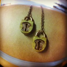 Lock pendants in Verawood we made for BFFs.  #omericaorganic #woodjewelry #madeindenver
