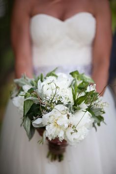 A lush #bouquet. Photography: White Photographie - www.whitephotographie.com, Floral Design: Bloomfields - bloomfieldsflowers.com  Read More: http://www.stylemepretty.com/canada-weddings/2014/05/28/rustic-meets-romantic-waring-house-wedding/