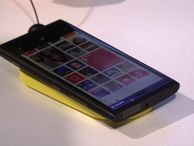 The Lumia 920, Nokia's new Windows Phone 8 device The Lumia 920 blends Microsoft's new Windows Phone 8 OS, Nokia PureView camera technology, plus NFC and wireless charging in one super-stylish package.