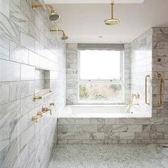 Large Walk In Marble Shower with His and Her Brass Shower Heads