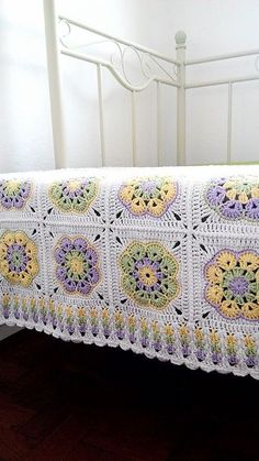 Ravelry: galunic's African Flower Blanket. This is a free pattern. The first click takes you to the finished product of the crocheter. But she gives you the click through to the free pattern. It is gorgeous and delicate. I will be making this one.