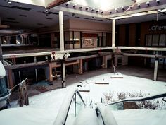 Snow falls into the abandoned Rolling Acres Mall in Akron. Images taken in February, 2015.