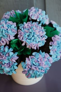 HYDRANGEA CUPCAKE BOUQUET - Using Glorious Treats& hydrangea frosting technique, I made this bouquet for a friend& mom& birthday. Chocolate cupcakes with vanilla buttercream. A step up from the usual rose cupcake bouquet!