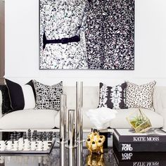 More from our house tour and #blackroosterinyourspace feature. Art by @thesefinewalls pillows and accessories via @blackrooster. Beautiful home of @blanccarte. See the full reveal - link in profile.