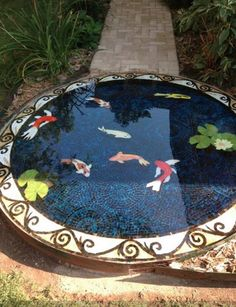 Post with 800 views. A neighbor posted this on FB, it's a glass mosaic koi pond. I thought it was good enough to share. Mosaic Garden Art, Mosaic Tile Art, Bird Bath Garden, Mosaic Artwork, Mosaic Diy, Mosaic Crafts, Mosaic Projects, Mosaic Birdbath, Mosaic Glass