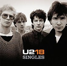 """U218 Singles is a greatest hits-style compilation album by the Irish rock band U2, released in November 2006. It contains (oddly enough) 19 songs: 17 of their most successful and popular singles, """"The Saints Are Coming"""" (a cover version in collaboration with Green Day of a song by The Skids) and """"Window in the Skies"""""""