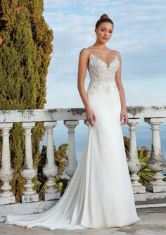Wow your guests in this stretch satin fit and flare gown. It features beaded appliqués on an illusion bodice and a clean skirt leading to the chapel length train. This look is romantic and sexy.