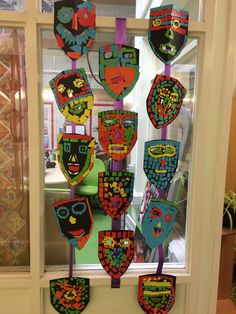 Love seeing these great Year 4 Mayan masks hanging outside the library!