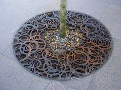 Tree grate at Aalborg City Center in Denmark by Frode Birk Nielsen