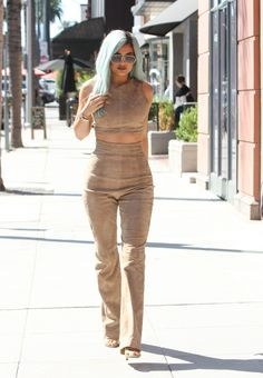 Kylie debuted her blue 'do in a matching suede crop top and pants set.   - Seventeen.com