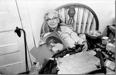 1975 - After the big clean up - the yellow bedroom where most of the action in the Maysles' documentary took place. The two ate, lived, and slept here. To Edie's left you can see the hot plate on her bed where she made her meals. Big Edie shows herself as a beautiful debutante in the picture.