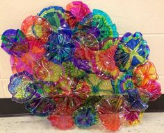 Our version of Chihuly's Bellaggio ceiling done by my 2nd and 3rd graders using permanent markers, clear plastic plates, and a heat gun. (Used by me of course!)
