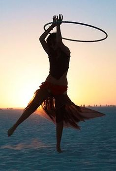 hula hooping on the beach