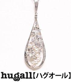 Mikimoto K18WG, 6.1x2cm, 60.3cm, 14.1g.