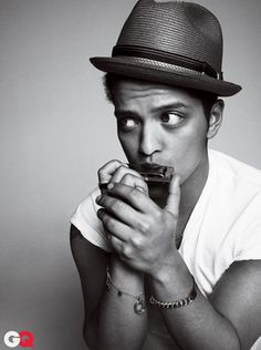 Bruno Mars has a pretty face and I respect his attempts to bring the pompadour back into fashion.