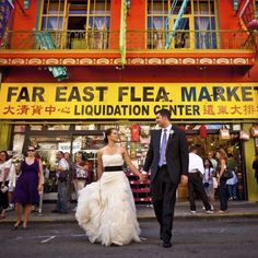 I think this wedding photo is just awesome! Way to be creative and take some shots in unexpected locations like China Town!