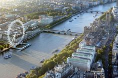 View of the London Eye and Thames from above! To see it all, you can even take a helicopter tour!