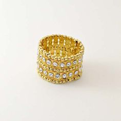 Artemis Gold by TuVous - $15.00  Gold metal beading and diamond sparkle give this bracelet a sophisticated pizzazz with elegant style.  Available at www.stylishvous.com