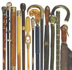 A GROUP OF TWENTY FOUR WALKING STICKS, CANES AND PARASOLS
