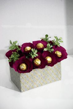 This candy bouquet makes a beautiful holiday centerpiece. Candy bouquet is made from 12 Ferrero Rocher chocolates. Each chocolate is wrapped in handmade flower petals made from burgundy crepe paper. C