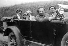 Alma Mahler with Alban Berg and his wife Helene; Franz Werfel at the wheel for a motoring trip. (Mid-1920s)