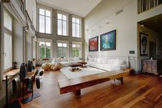 Art decor living room with white couch and large plank hardwood floor