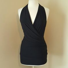 SALE! Black Dressy Halter Strtchy black fabric. Fabric is gathered in the back. No tag for the size but most likely M/L. Classy wrapped halter. Dress it up or down. Been sitting in storage for awhile but worn maybe once or twice. Papaya Tops Blouses