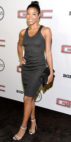 GABRIELLE UNION in a body conscious grey tank dress, strappy heels, clutch and hair pulled back.