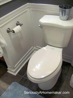 Bathroom: white wainscot, dark floors