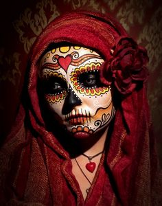 Day of the Dead face art inspired by traditional Mexican sugar skulls.