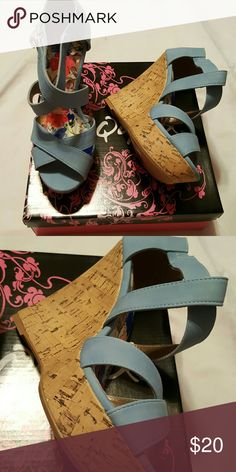 Light Blue Crossover Wedges Brand new 5 inch Wedges with 1.5 inch toe platform. Top is a suede feel and heel is made of heavy cork. Qupid Shoes Wedges