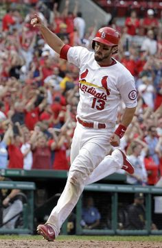 Matt Carpenter celebrates as he heads home to score the game-winning run during the 12th inning of a baseball game against the Pittsburgh Pirates...Cards won 6-5.  8-15-13