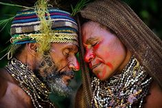 A quiet moment during a courtship ritual in the western highlands of Papua New Guinea.