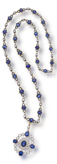 An antique sapphire and diamond necklace, circa 1895. The chain and detachable pendant set with cushion-cut sapphires and old mine-cut diamonds; estimated total diamond weight: 7.60 carats; mounted in silver topped gold; length: 20in.; length of pendant: 2in.