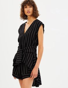 - Length: Shortest: 63cm; Longest: 115cm (size AU 8) - Regular fit; cinched at the waist - Lightweight woven fabric; non-stretch; unlined - Cut-out to back; tie fastening to nape - Dramatic high-low hemline - Tie waist