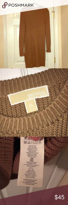 Michael Kors sweater dress Authentic Michael Kors sweater dress, size XS - the color is a dark camel. Super comfy & warm! Just too big for me. No flaws. Worn a few times Michael Kors Dresses Midi