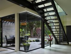 Love this courtyard and staircase. Borrow from the Bauhaus for a modernist landscape design on Houzz.com.