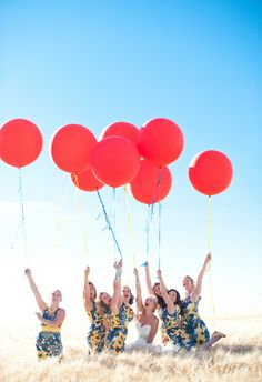 Bridesmaids in casual yellow and blue dresses, big red balloons // Orange Photographie