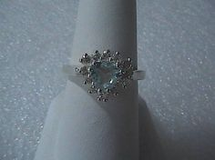 Pre-owned Sterling Topaz & CZ Heart Ring, 6 x 5 Heart Shaped Blue Topaz, 12 pieces 2 mm CZ around it. Weigh 23.3 grams, hallmarked 925, size 7.