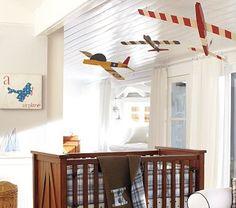 cute nursery for a boy and a plane mobile! cute!