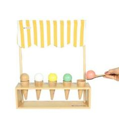 Nobodinoz Ice Cream Corner, Made with FSC certified beech wood, the set includes a wooden stand, a spoon for serving and a honey-striped tent cover. Ice Cream Games, Ice Cream Stand, Eating Ice Cream, Handmade Wooden Toys, Busy Board, Funky Design, Deco, Kids Learning, Kids Toys