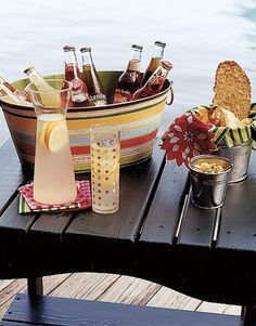 Refreshments:     By serving fruity sodas and fresh-squeezed lemonade, party guests can choose which beverage will best quench their thirst. Keep bottles cool in a colorful, striped galvanized tub filled with ice.