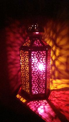 CAN MAKE THIS WITH COLORED SULAFANE INSIDE THE LANTERN THEN USE BATTERY OPERATED CANDLES FOR THE SAME EFFECT...  Moroccan lantern
