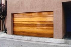 MODERN GARAGE DOORS In a struggling housing market in California, things become harder for home owners, real estate agents and potential buyers alike. If you are thinking of how to expand your home's or client's home's equity and appeal, don't look farther than your garage. We here at Tungsten Royce work hard