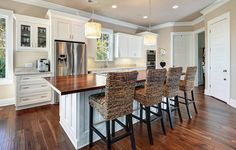 White fusion kitchen, love the butcher block on the island matching the floor