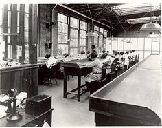 """Radium dial painters working in a factory for the United States Radium Corporation.  The company spread misinformation to deny the dangers of Radium, allowing more workers to be exposed and sickened, until the """"Radium Girls"""" took them to court, exposing the matter to the media and public scrutiny.  The women from the court case mostly died, painfully, in their thirties."""
