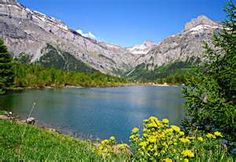 Swiss Alps are a perfect tourist destination for both summer lake-side ...