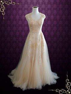 So soft and romantic, featuring beautiful soft V shaped neckline finished with a soft tulle lace skirt that drapes down nicely. See our lovely bride in this dress. This dress can also be made in all i